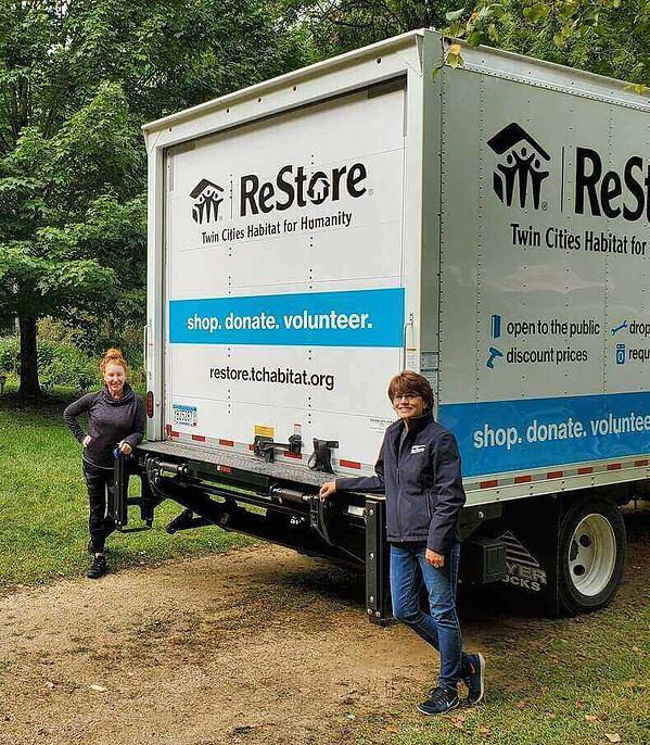 Robin and a member of the donations team with the ReStore donations truck.