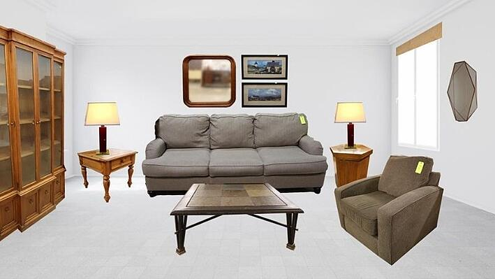 Living room with basic furniture and decor from ReStore.