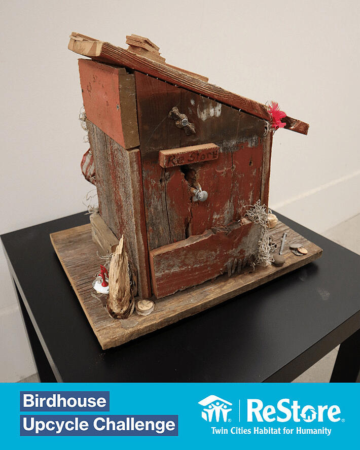 Red upcycled birdhouse.