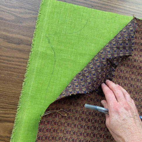 Tracing the shape of the fabric.