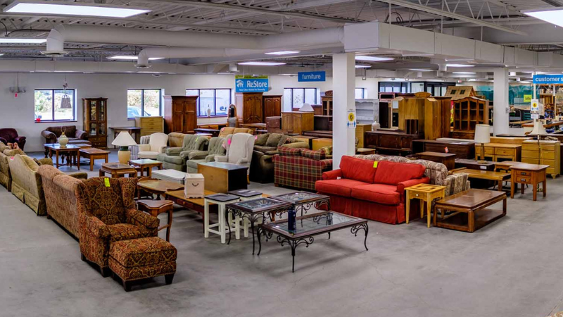 A look inside the New Brighton ReStore, featuring an assortment of furniture.