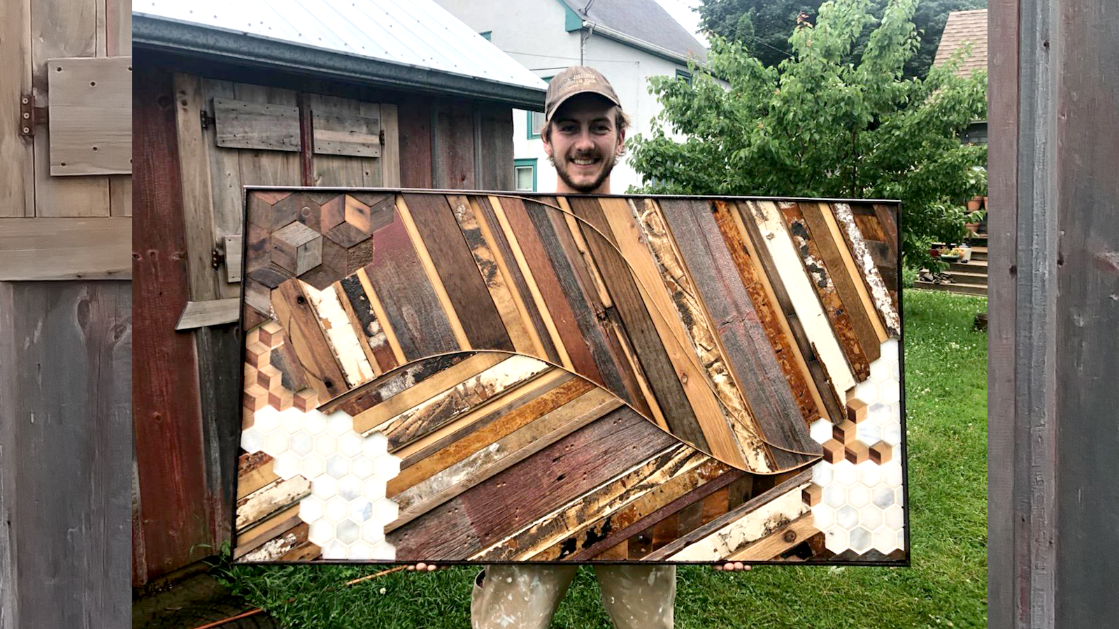 Joey Ford holding an art piece he made