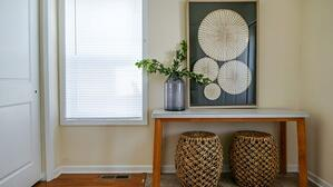 An entryway furnished with ReStore items.
