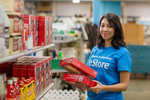 A volunteer stocking shelves.