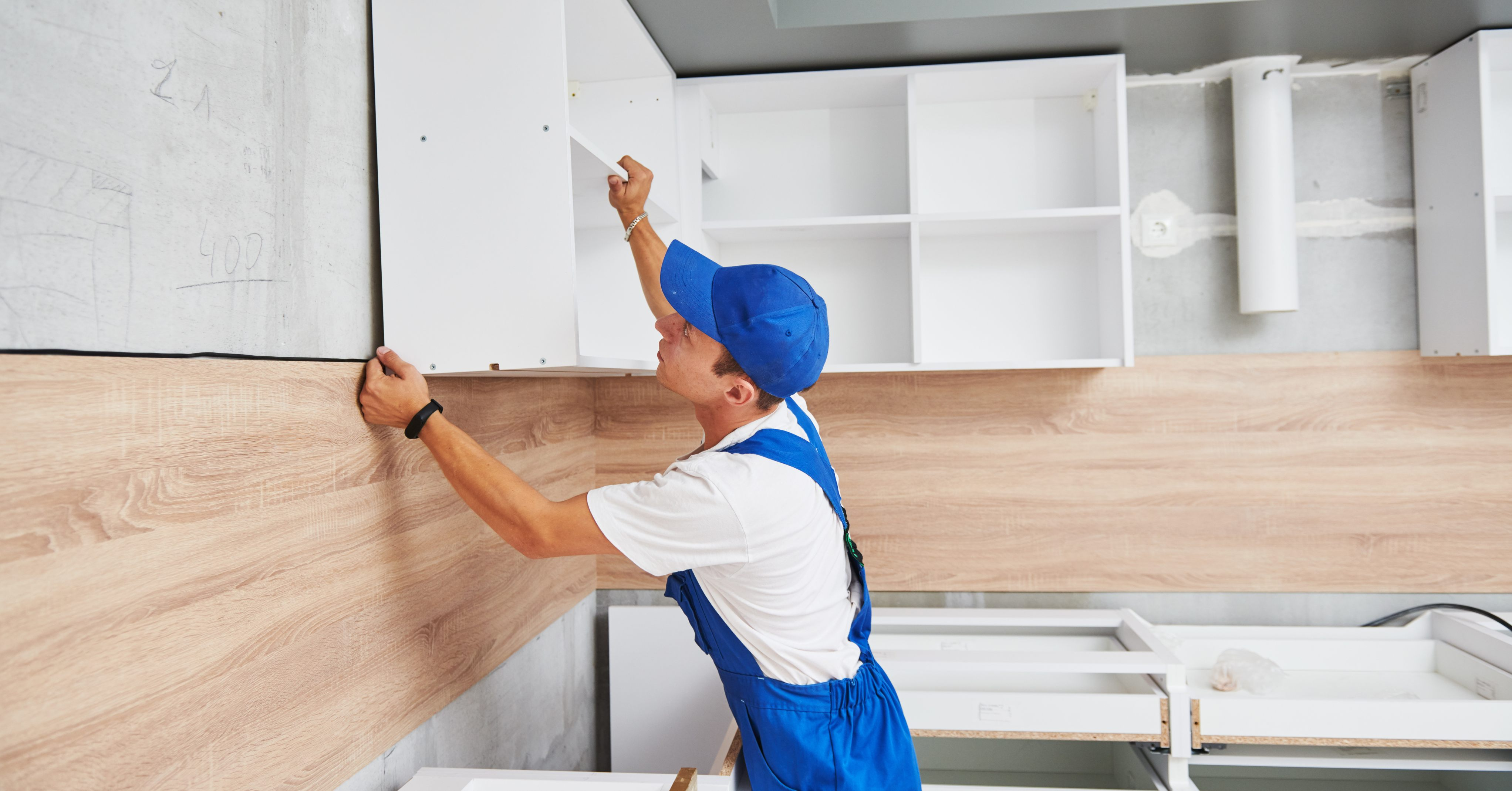 How to Install Kitchen Cabinets All By Yourself - homeowner installing kitchen cabinets, renovating, remodeling – ReStore