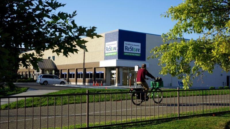 Someone biking past the Minneapolis ReStore.