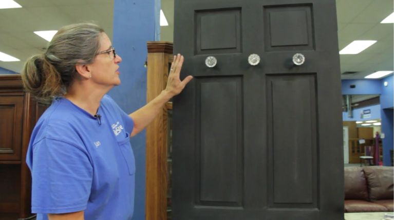 Jan showing off mudroom cabinets.