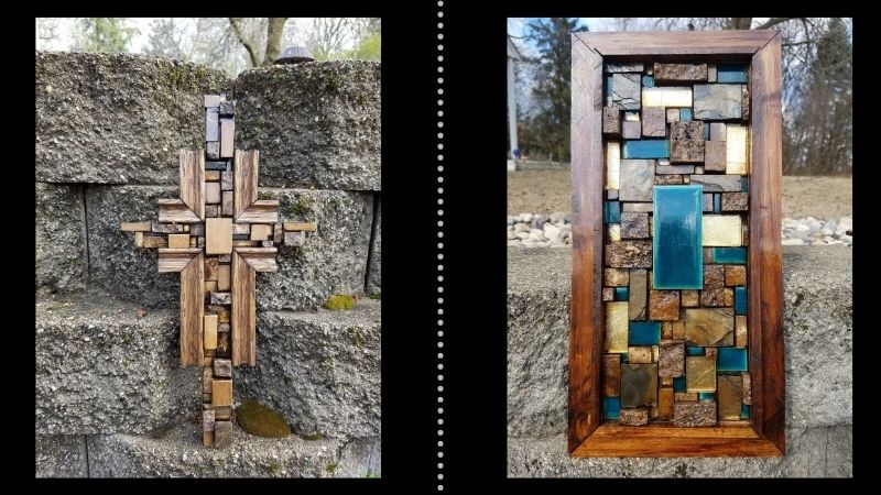 A wooden cross and piece of framed art made out of tiles.