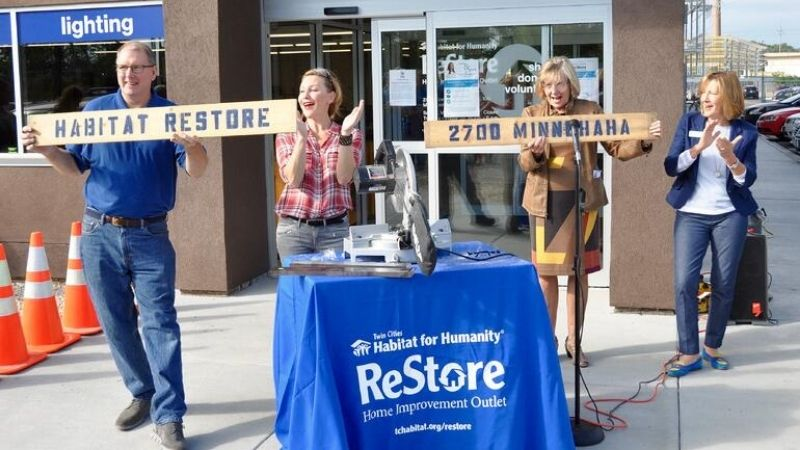 """The """"board-cutting"""" at the opening celebration of the Minneapolis ReStore."""