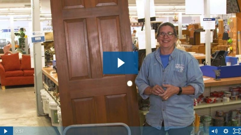 A preview image of Jan showing off a door.