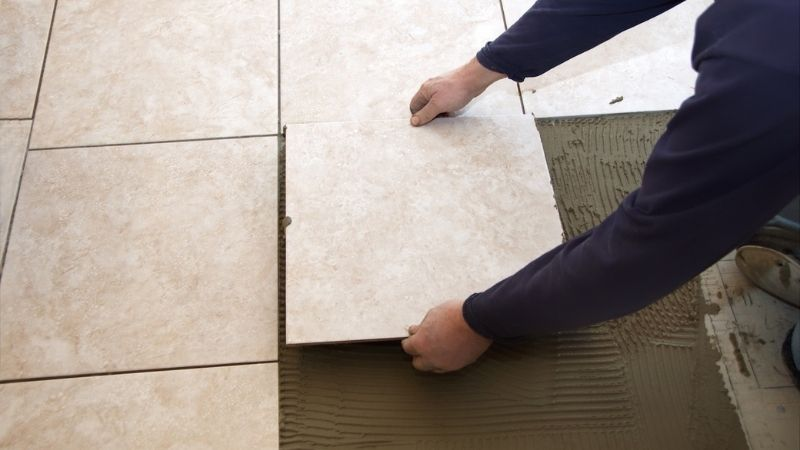 Laying tile for a new floor.