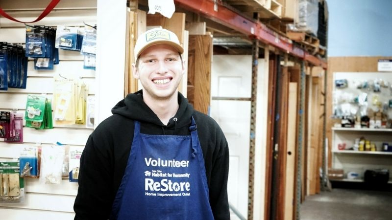 Gregory in a volunteer apron.